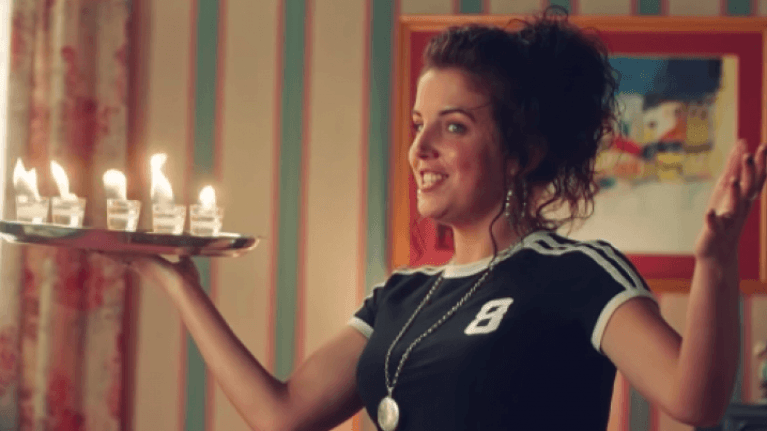Jamie-Lee O'Donnell serves everyone flaming drinks in the first season of <i>Derry Girls</i> (Channel 4/Netflix)