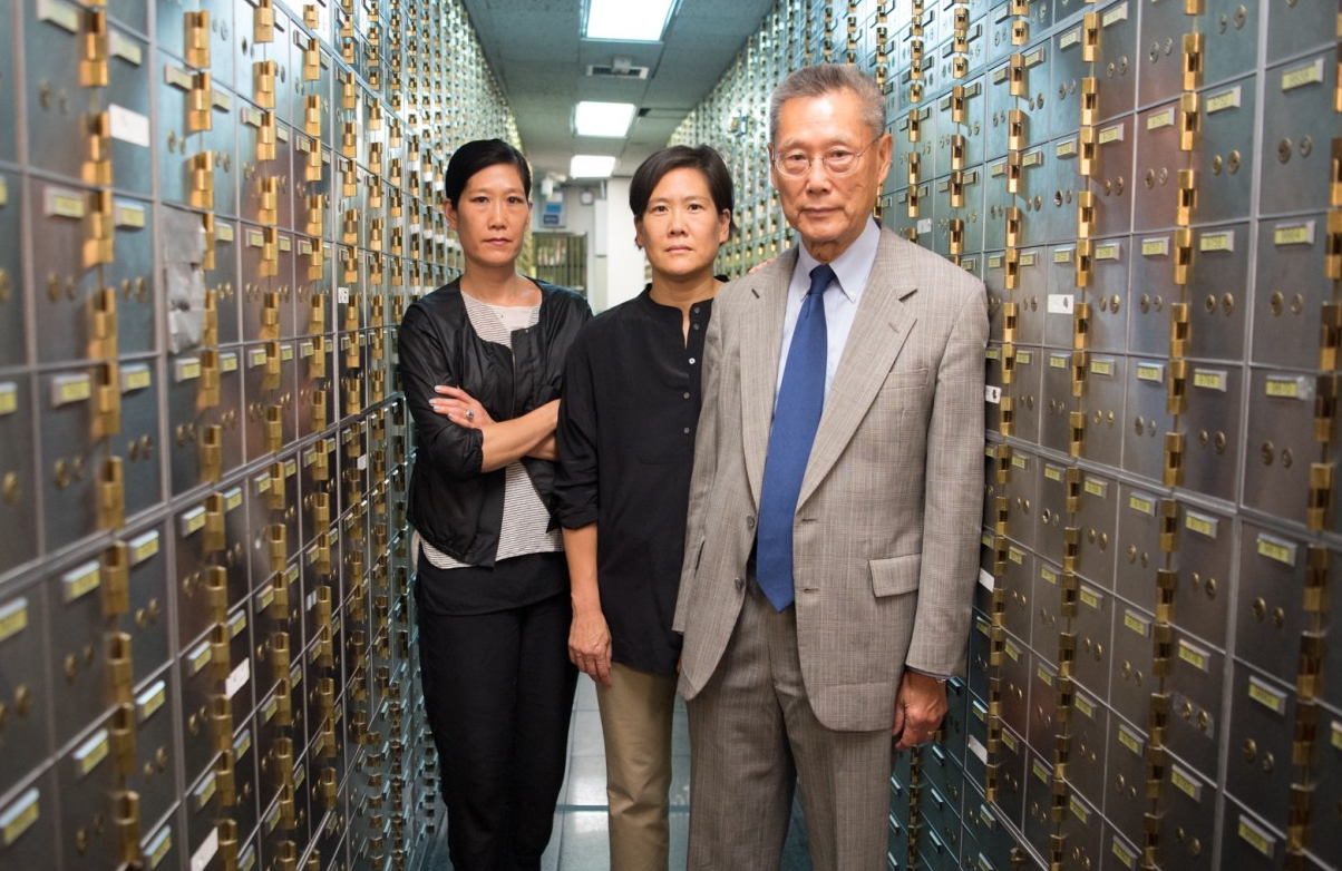 Vera Sung, Jill Sung, and Thomas Sung of Abacus Federal Savings Bank, in a promotional image for <i>Abacus: Small Enough to Jail</i>. (PBS)