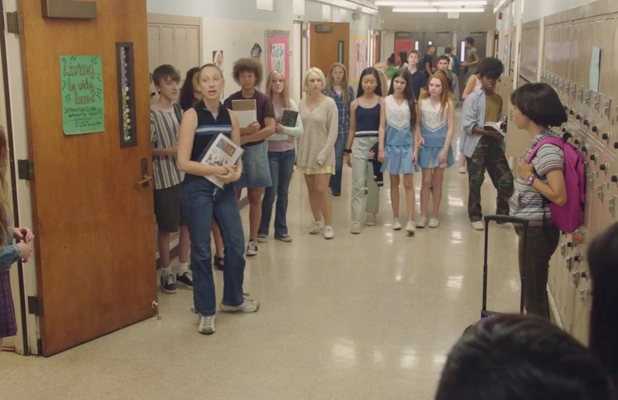 Anna (Anna Konkle) stages a demonstration in the hallway in a misguided attempt to support her friend Maya (Maya Erskine). (Hulu)