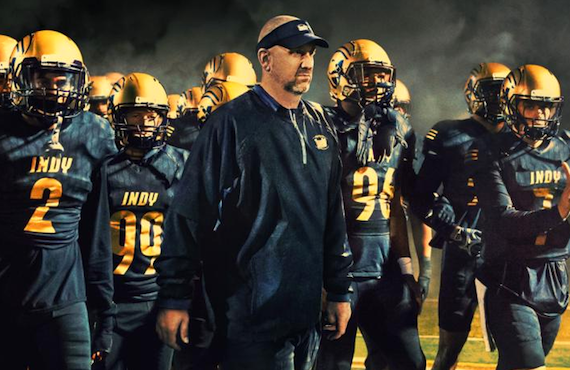 Coach Jason Brown leads his charges at Independence Community College onto the field in Last Chance U. (Netflix)