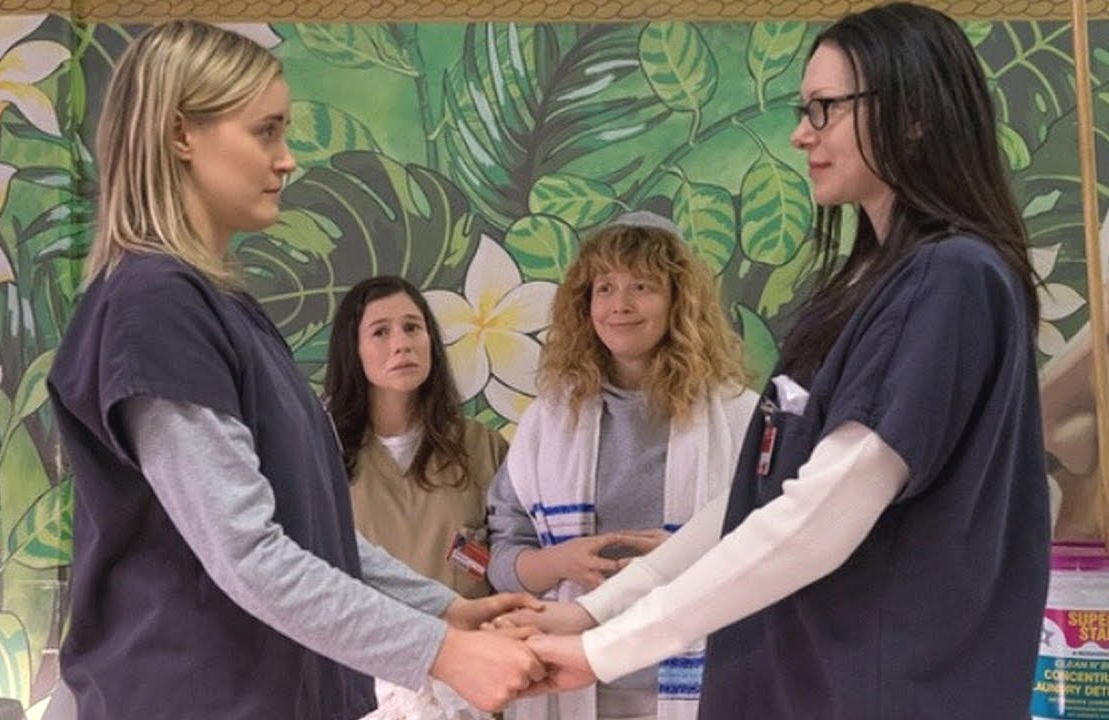 Nicky (Natasha Lyonne) officiated Piper (Taylor Schilling) and Alex's (Laura Prepon) prison wedding in Orange is the New Black Season 6. (Netflix)