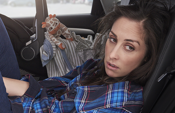 Kate (series creator and star Catherine Reitman) finds a moment to herself in Workin' Moms. (CBC/Netflix)