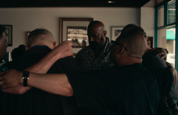 Larry Anderson (facing camera) leads prayer at a Fellowship-related prayer group in Portland, Oregon. (Netflix)