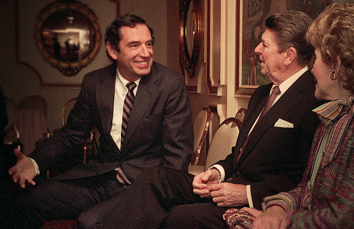 Doug Coe, the ultra-low-key leader of The Fellowship, meeting with Ronald and Nancy Reagan. (Netflix)