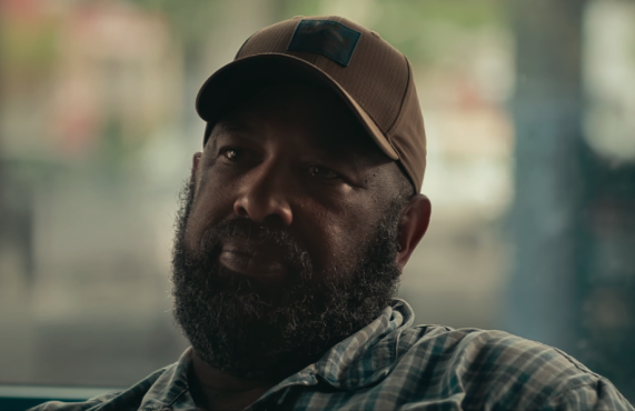 Larry Anderson speaking truth to Jesse Moss, director of <i>The Family</i>. (Netflix)