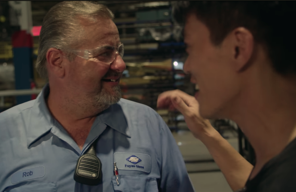 Rob and Wong, coworkers at the Fuyao Auto Glass plant in Ohio, share a light moment. (Netflix)