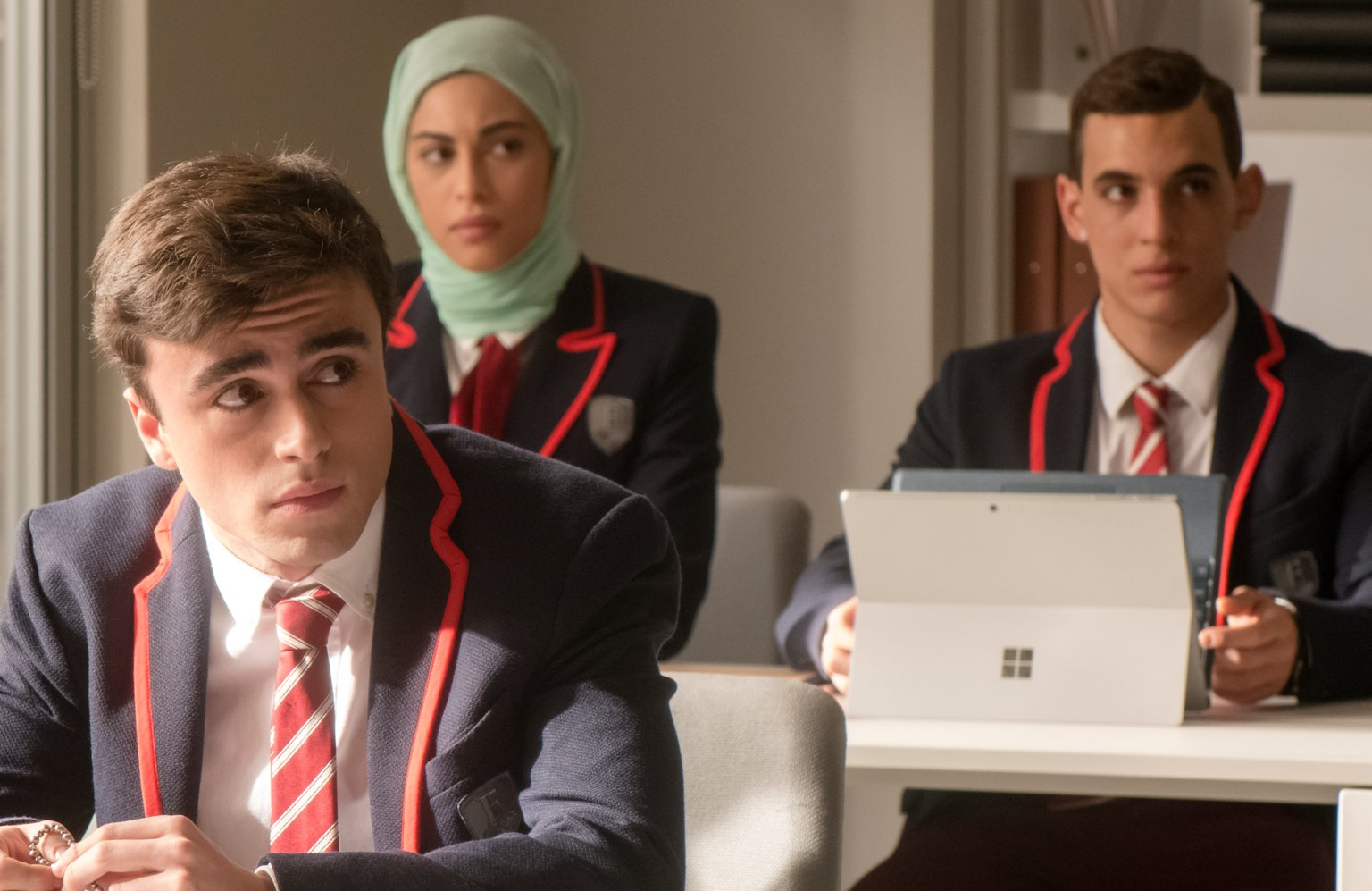 Itzan Escamilla as Samuel, Mina El Hammani as Nadia, and Miguel Herrán as Christian in Elite. (Manuel Fernandez-Valdes/Netflix)