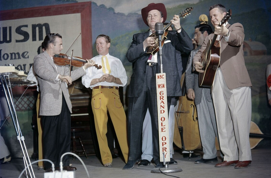 Bill Monroe on the Grand Ole Opry, Nashville, circa-1958, as featured in Country Music (Photo: Les Leverett Collection, Grand Ole Opry Archives / PBS)