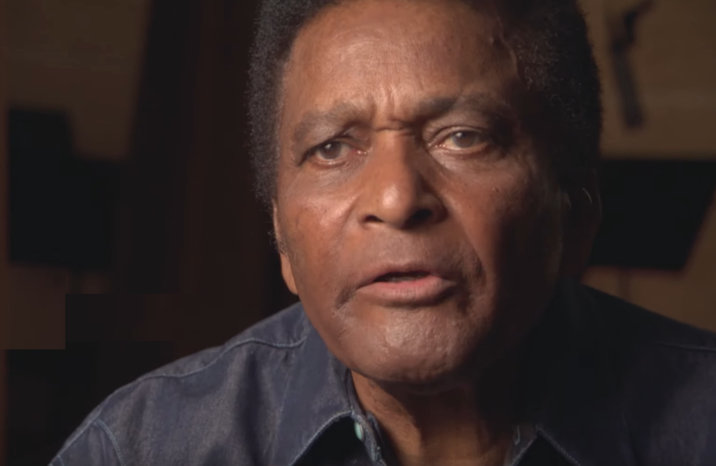 Singer Charley Pride tells Burns that his record label initially sent his music out without photos in attempt to hide that he is black. (Photo: Country Music/ PBS)