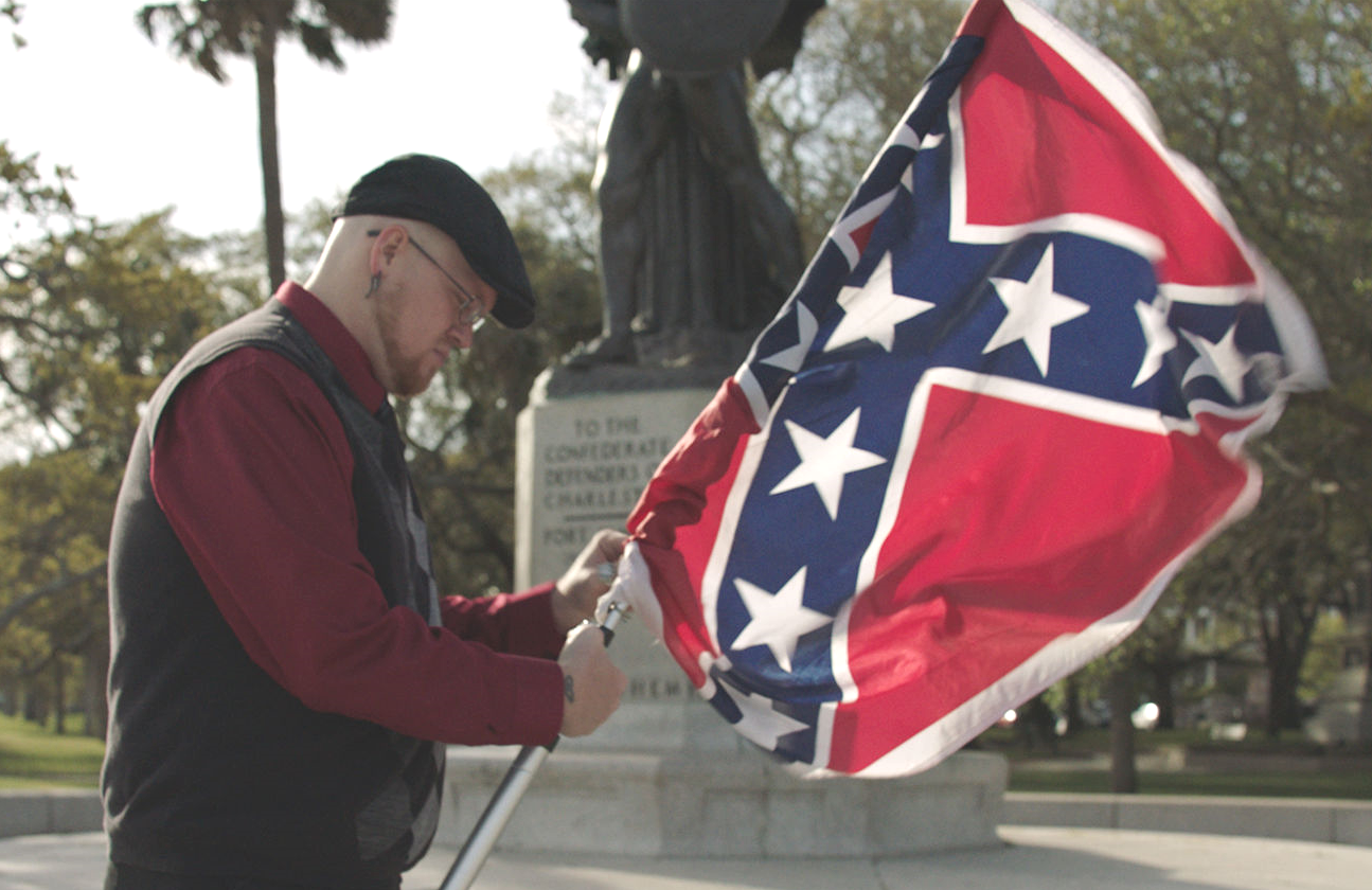 James Bessenger of the South Carolina Secessionist Party unfurls his Confederate Flag in Why We Hate. (Photo: Amblin Entertainment/Discovery)