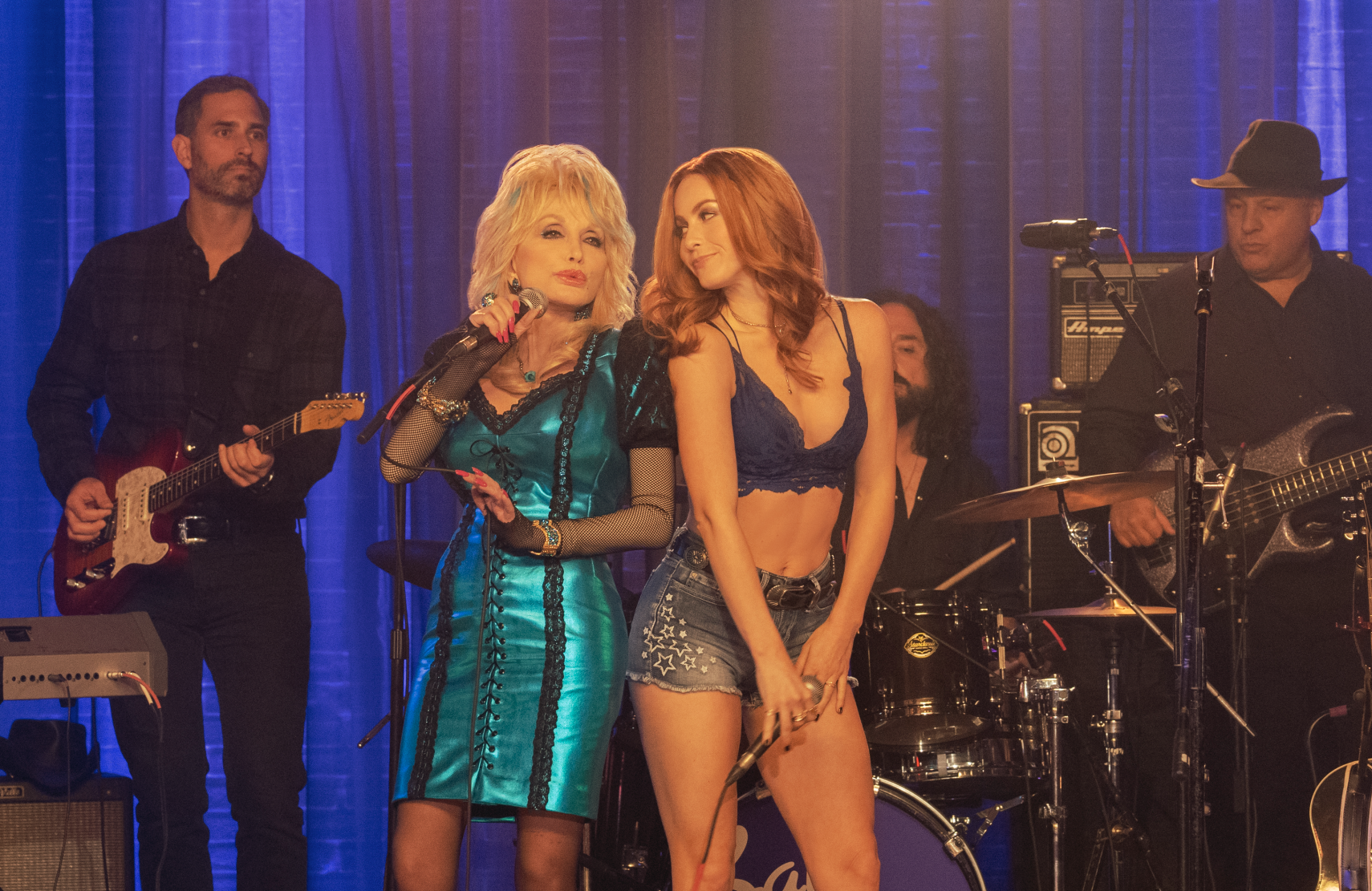 Dolly Parton lights up the screen every time she appears in Heartstrings, here alongside Julianne Hough, who plays Jolene from Parton's iconic song. (Netflix)