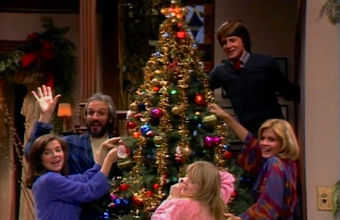 "Justine Bateman, Michael Gross, Tina Yothers, Michael. J. Fox, and Meredith Baxter in Family Ties ""A Keaton Christmas Carol"" (Paramount Television)"