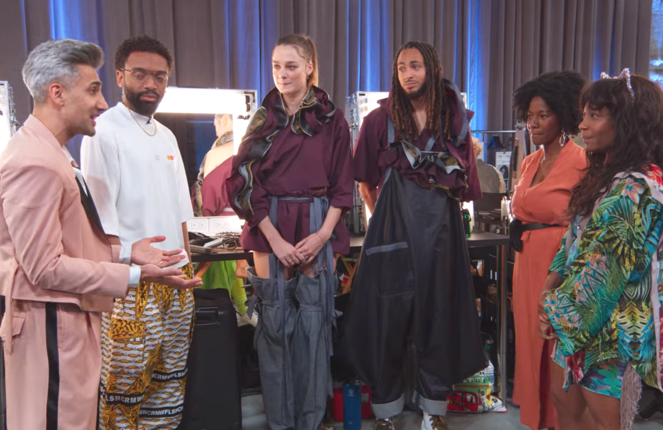 Tan France and Kerby Jean-Raymond critique Farai Simoyi-Agbede and KiKi Peterson in Next in Fashion. (Netflix)