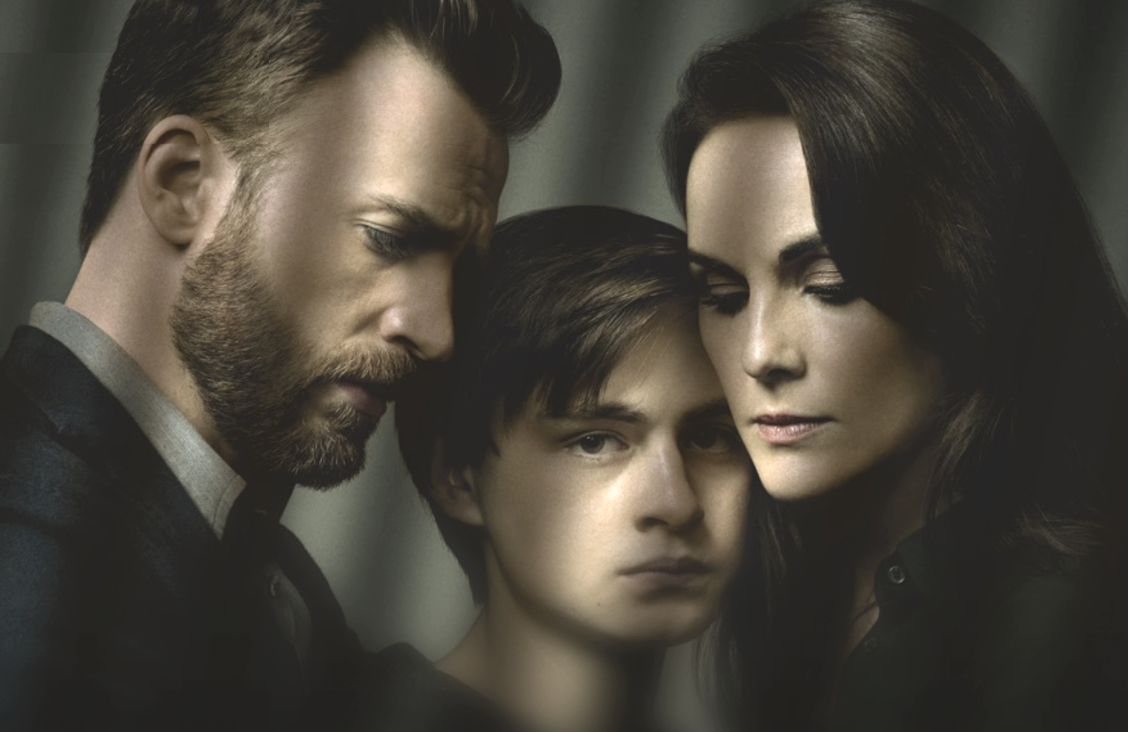 Chris Evans, Jaeden Martell, and Michelle Dockery in Defending Jacob. (Apple TV+)
