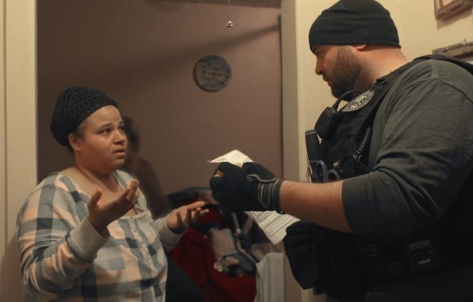 An ICE officer exercises a warrant in Netflix's Immigration Nation.