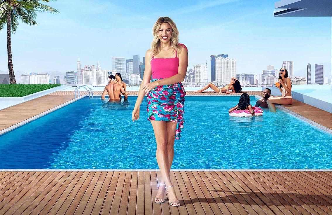 Arielle Vandenberg returns as host of the Las Vegas-set second season of Love Island. (Photo CBS)