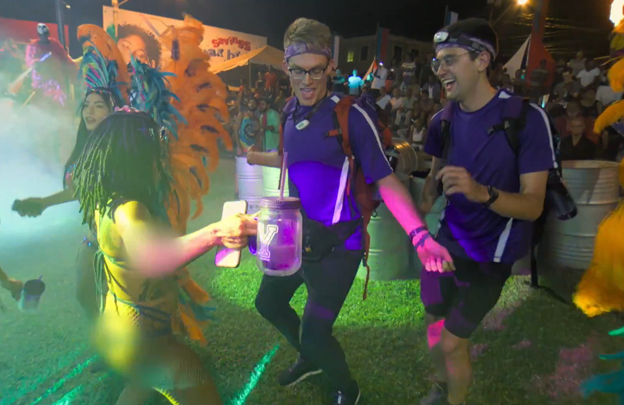 Remember dancing? Amazing Race contestants Will Jardell and James Wallington take in carnival in Trinidad in the season opener. (Photo: CBS)