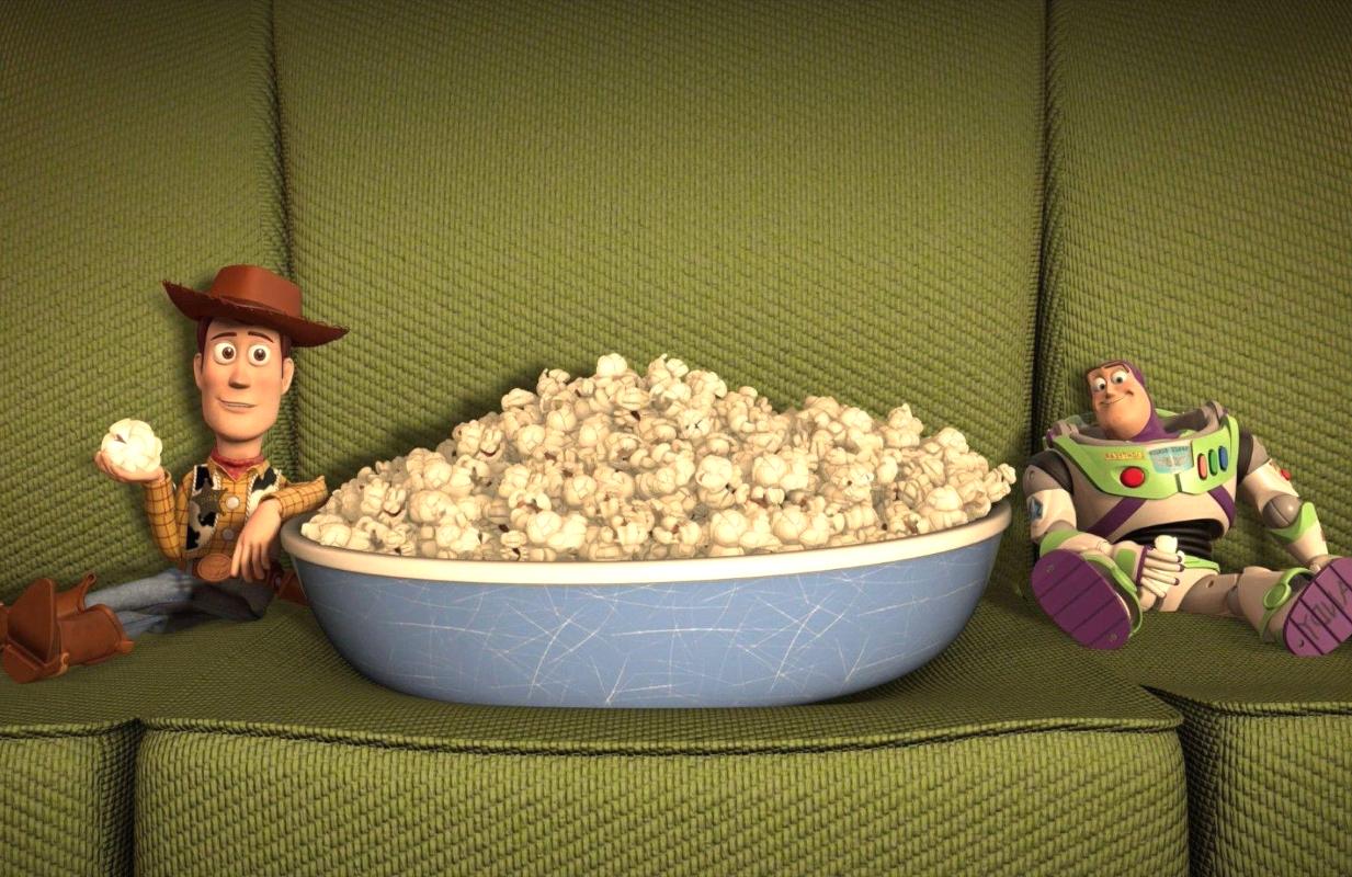 Woody and Buzz Lightyear enjoy Pixar popcorn. Will you? (Photo: Pixar/Disney)