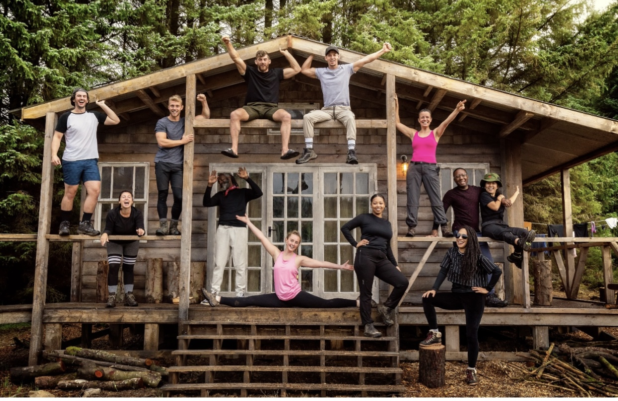 The original twelve campmates before any eliminations... I felt I had to do the splits to show off... as I knew my bridge building wasn't going to impress anyone! (Photo: Channel 4/HBO Max)