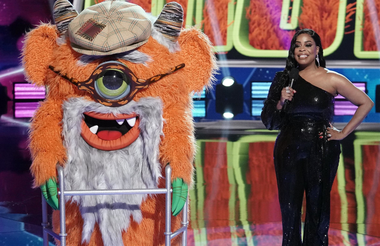 Grandpa Monster and host Niecy Nash in tonight's premiere of The Masked Singer. (Photo: Michael Becker/FOX)