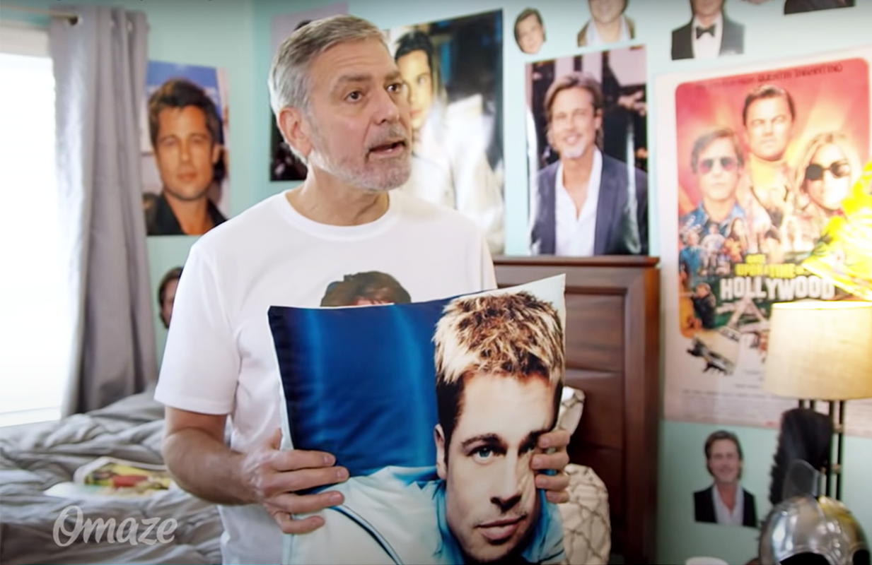 Superfan George Clooney shows off his Brad Pitt shrine in new ad (Photo: YouTube)