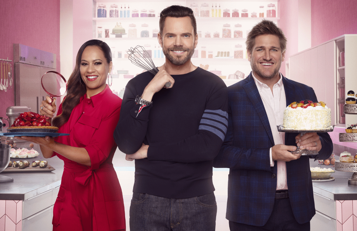Host Joel McHale (center) with judges Yolanda Gampp and and Curtis Stone on the set of Crime Scene Kitchen. (Photo: Michael Becker/FOX)
