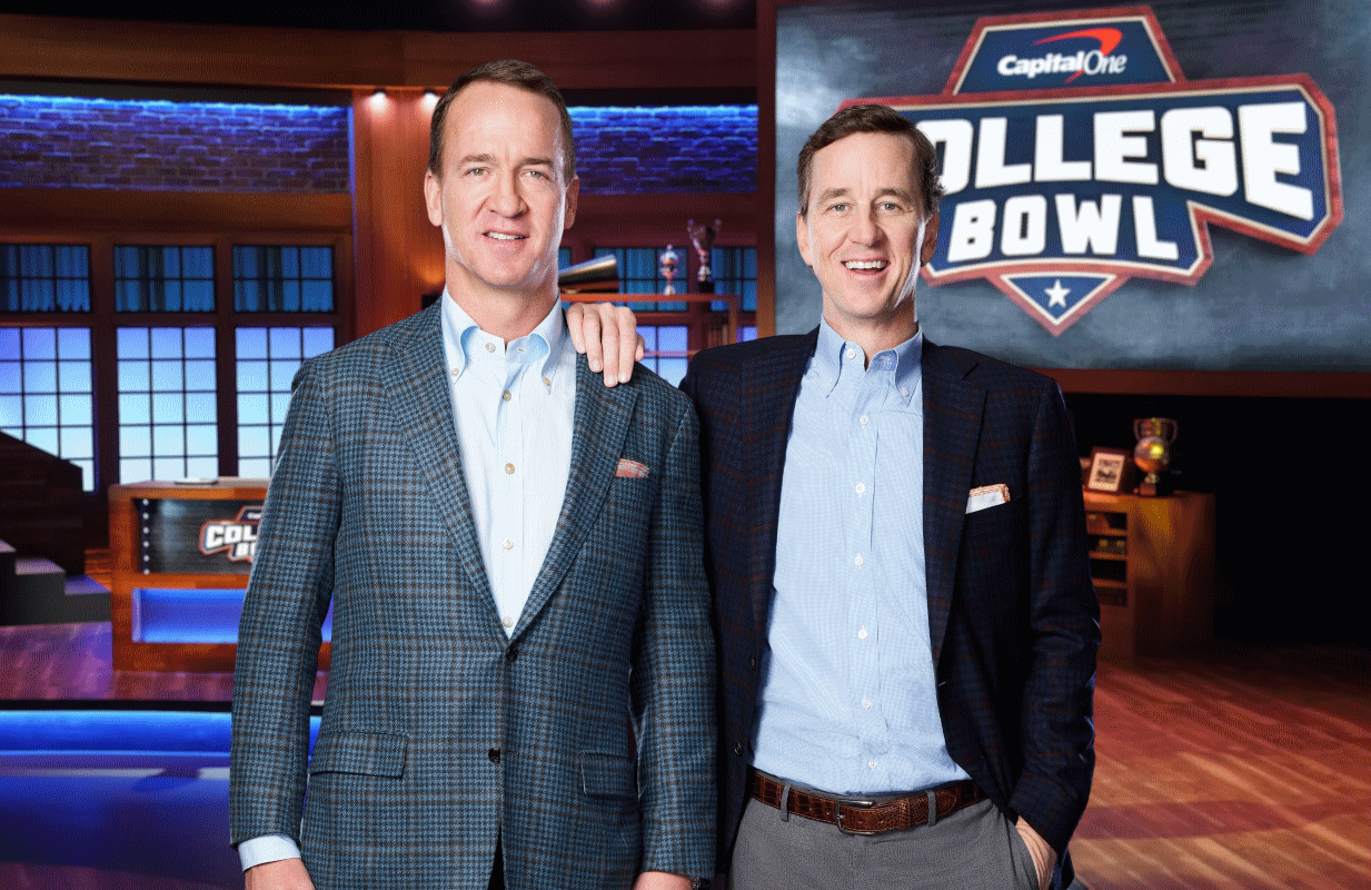 Peyton and Cooper Manning host NBC's Capital One College Bowl. (Photo by: Chris Haston/NBC)