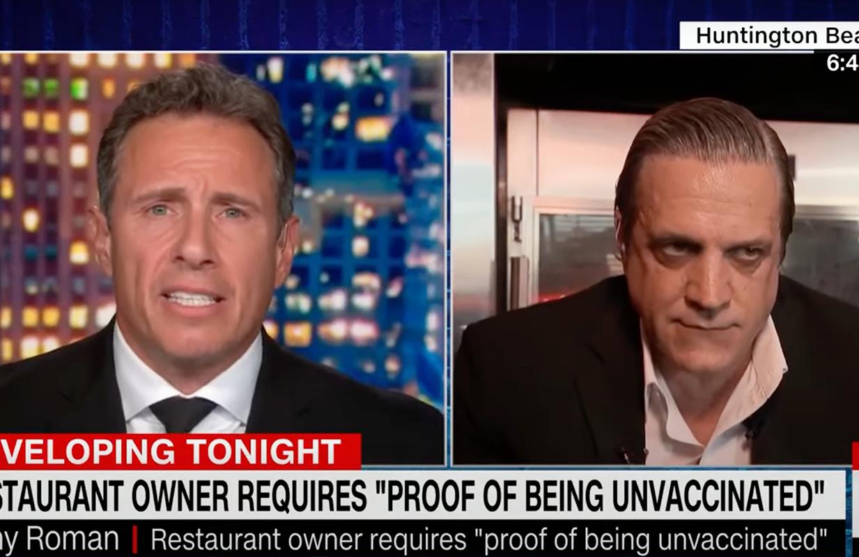 Chris Cuomo and anti-vax restaurant owner Tony Roman. (Photo: CNN)