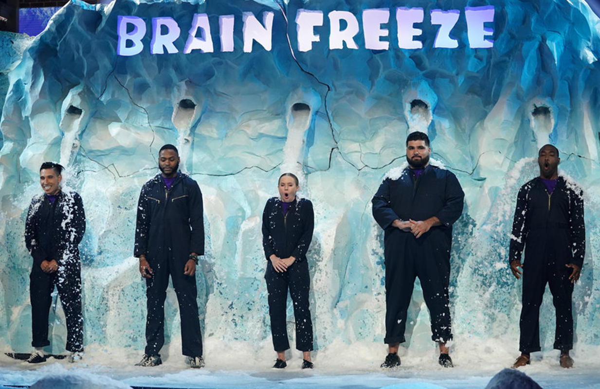 """Bell and her teammates get hit with a """"Brain Freeze"""" after a particularly dismal guess. (Photo: Elizabeth Morris/NBC)"""