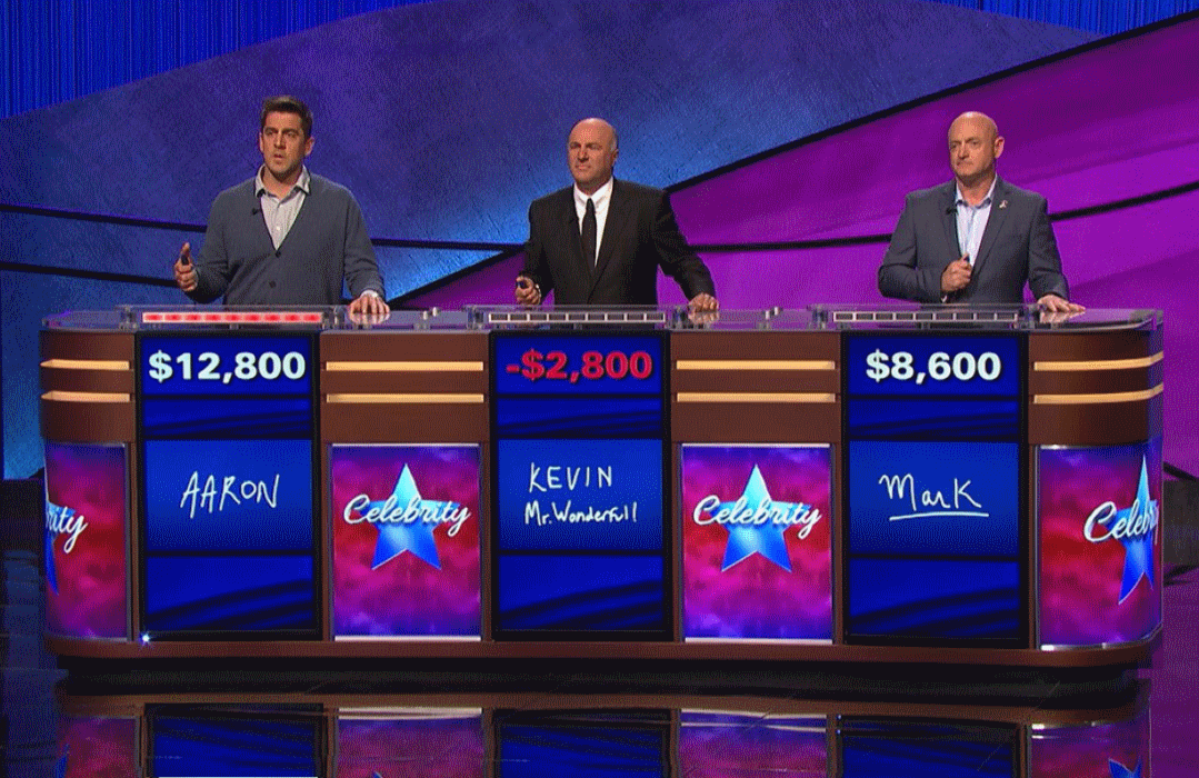 O'Leary (center) had the misfortune of competing against  two particularly brainy celebs in Aaron Rodgers (left) and Mark Kelly (right), but he can't blame them for his negative score.