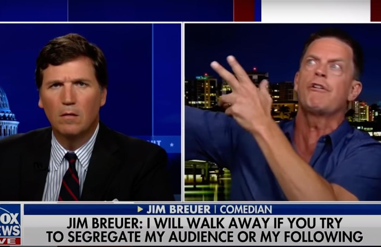 Tucker Carlson looks on as Jim Breuer spouts anti-vaxx talking points. (Photo: Fox News)