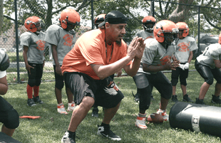 Coach Gawuala with the 9U team in We Are: The Brooklyn Saints. (Photo: NETFLIX)